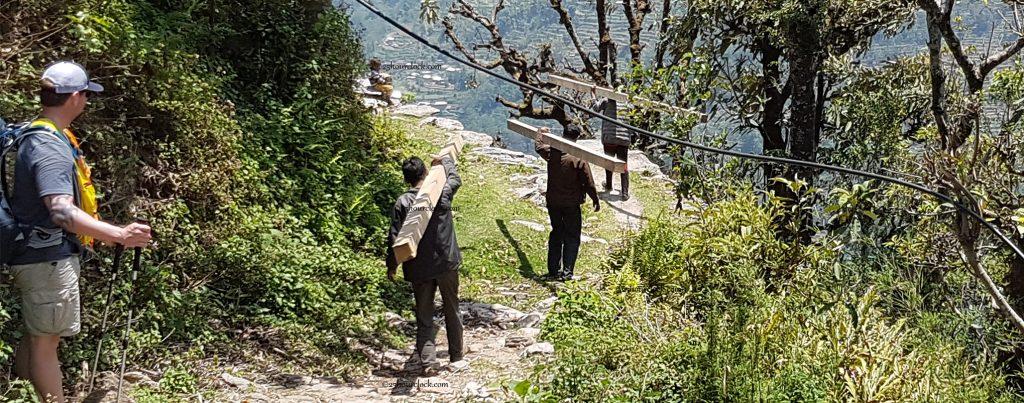 Nepalis carrying wood